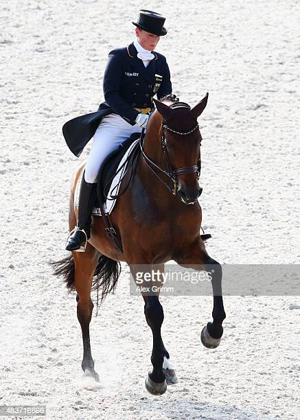 Isabell Werth of Germany competes on her horse Don Johnson FRH in the Dressage Grand Prix team final and individual qualifier competition during Day...