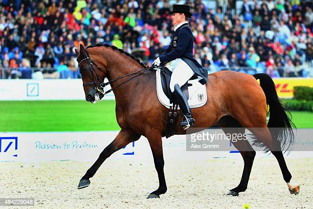 Isabell Werth of Germany performs on her horse Don Johnson FRH during the Dressage Grand Prix Freestyle individual competition on Day 5 of the FEI...