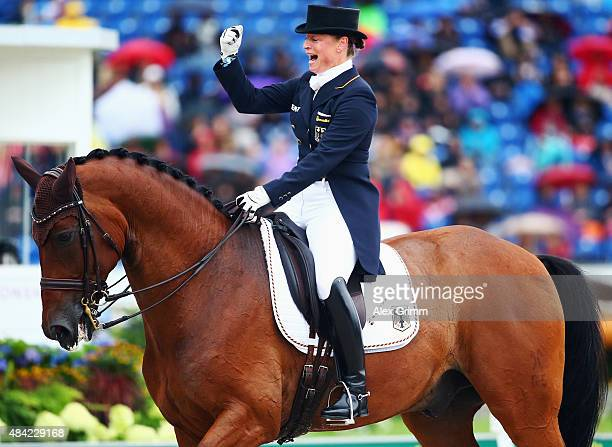 Isabell Werth of Germany reacts after performing on her horse Don Johnson FRH during the Dressage Grand Prix Freestyle individual competition on Day...