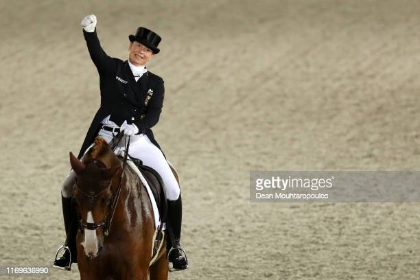 Isabell Werth of Germany riding Bella Rose celebrates after she competes during Day 4 of the Longines Grand Prix Special FEI Dressage European...