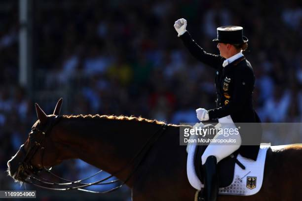 Isabell Werth of Germany riding Bella Rose celebrates after she competes during Day 6 of the Grand Prix Freestyle, Longines FEI Dressage European...