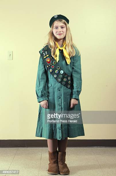 Isabella Chandler a Girl Scout with Troop 42 in Cumberland and North Yarmouth models a Girl Scouts uniform used from 19481959 Photographed at the...