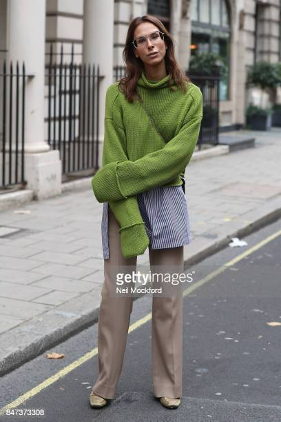 Isabella Charlotta Poppius is seen wearing an Amanda Wakeley bright lime cropped oversized sweater knit layered with long tunic shirt with stripes...