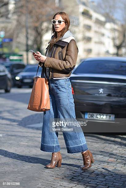 Isabella Charlotta Poppius poses wearing Burberry shearling aviator jacket a Stella McCartney cashmere hoodie and sunglassesCitizens of Humanity...