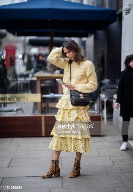 Isabella Charlotta Poppius wearing a Black Celine Classic Box Bag Samsoe Samsoe pastel yellow fluffy knit sweater Baum und Pferdgarten pale yellow...