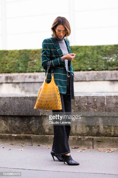 Isabella Charlotta Poppius wearing a grey turtleneck sweater green checked blazer dark wash jeans yellow bag and black heels is seen before the...