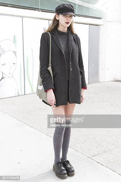 Isabella Ching wears Doctor Martens boots Vintage Skirt HM coat and Vintage hat during Mercedes Benz Fashion Week at Ifema on February 19 2016 in...
