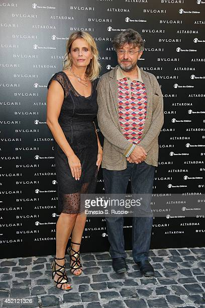 Isabella Ferrari and Aldo Nove attend the 'Isabella Ferrari Forma/Luce' cocktail party at Horti Sallustiani on July 13, 2014 in Rome, Italy.