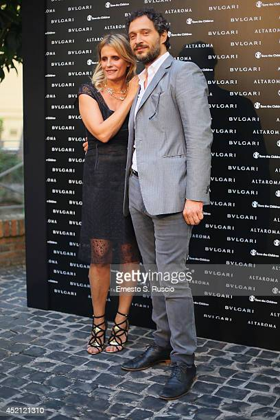 Isabella Ferrari and Claudio Santamaria attend the 'Isabella Ferrari Forma/Luce' cocktail party at Horti Sallustiani on July 13, 2014 in Rome, Italy.