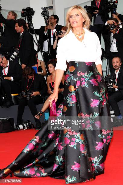 Isabella Ferrari walks the red carpet ahead of the Opening Ceremony and the La Vérité screening during the 76th Venice Film Festival at Sala Grande...