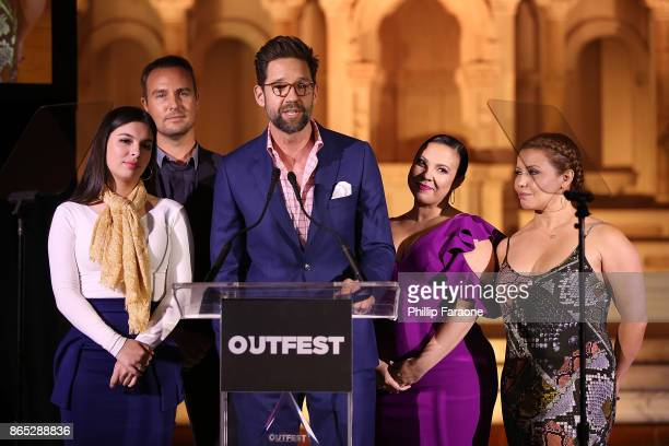 Isabella Gomez Brent Miller Todd Grinnell Gloria Calderon Kellett and Justina Machado speak onstage at the 13th Annual Outfest Legacy Awards at...