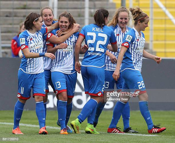Isabella Hartig of Hoffenheim celebrates her first goal together with teammates during the women Bundesliga match between FC Bayern Muenchen and 1899...
