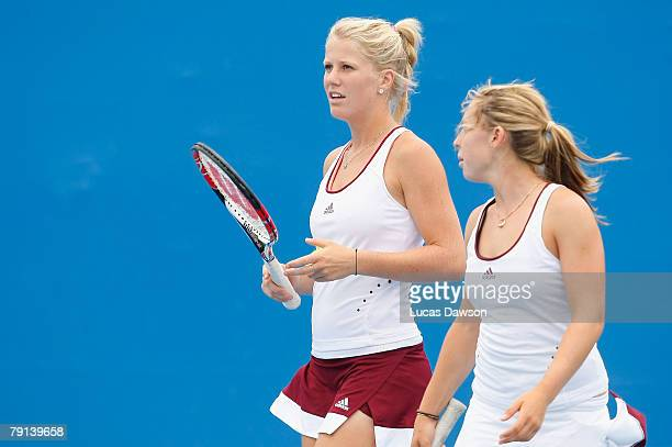 Isabella Holland and Sally Peers of Australia talk tactics during their junior doubles against Simona Halep of Romania and Katarzyna Piter of Poland...