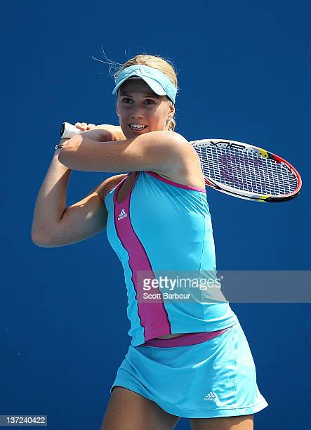Isabella Holland of Australia plays a backhand in her first round match against Shahar Peer of Israel during day two of the 2012 Australian Open at...