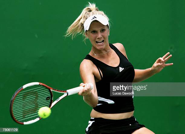 Isabella Holland of Australia plays a forehand during her first round juniors match against Nadiya Kichenok of the Ukraine on day eight of the...