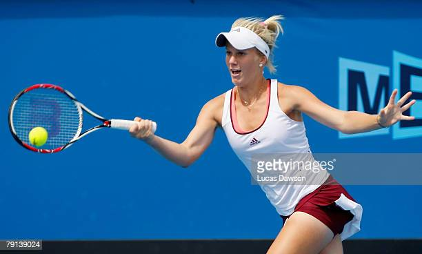 Isabella Holland of Australia plays a forehand during her junior girls match against Lesley Kerkhove of the Netherlands on day eight of the...