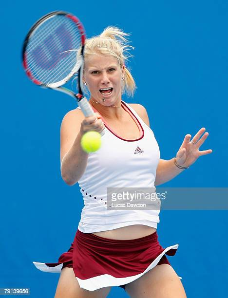 Isabella Holland of Australia plays a forehand during her junior doubles match with Sally Peers of Australia against Simona Halep of Romania and...