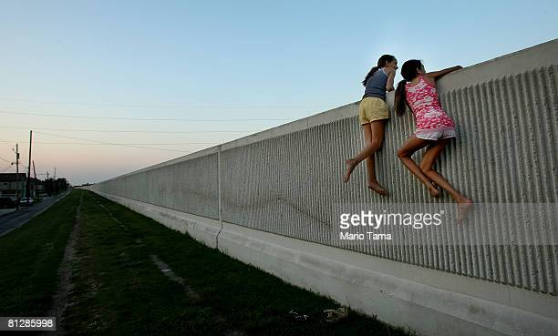 Isabella Lander and Arabella Christiansen climb on the 17th Street Canal levee May 29 2008 in Metairie Louisiana Despite $22 million in repairs the...