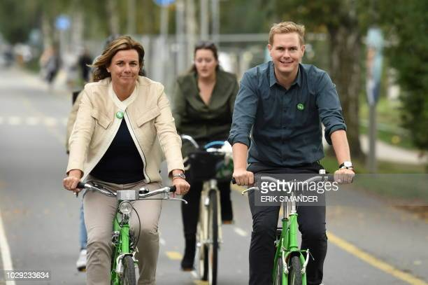 Isabella Lovin and Gustav Fridolin spokespersons for the Green Party ride bikes to join the Peoples Climate March in Stockholm Sweden September 8...