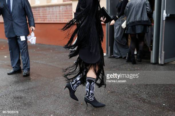 Isabella Manfredi wearing tassel jacket and skirt and embroidery western boots during MercedesBenz Fashion Week Resort 19 Collections at...