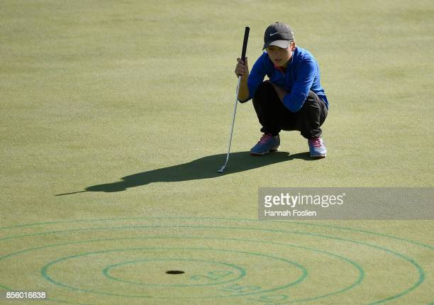 Isabella McCauley participates in the putting contest at the regional round of the Drive Chip and Putt Championship on September 30 2017 at...