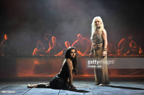 Isabella Nefar as Salome SoCalled and Olwen Fouere as Nameless with artists of the company in the National Theatre's production of Yael Farber's...