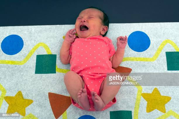 Isabella Prado five days old cries out during a checkup at the Inner City Health Center in Denver Colorado on March 15 2017 Inner City Health Center...