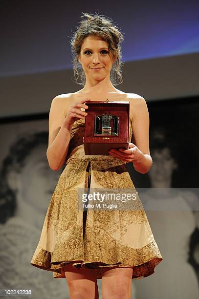 Isabella Ragonese poses with the award for Best Supporter Actress during the Nastri d'Argento ceremony awards on June 19 2010 in Taormina Italy