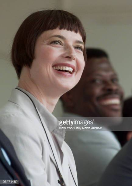 Isabella Rossellini, and behind her, New York Knicks' Patrick Ewing, flash big smiles at the adoption fair in Central Park. Six years ago, Rossellini...