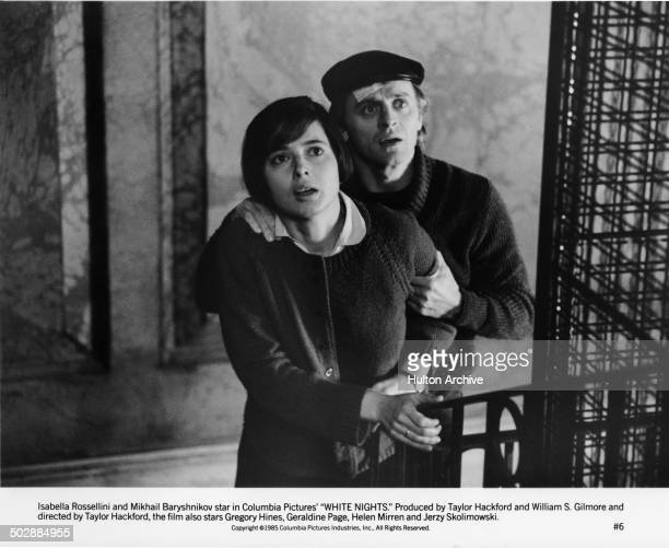 Isabella Rossellini and Mikhail Baryshnikov try to escape in a scene for the movie'White Nights' circa 1985
