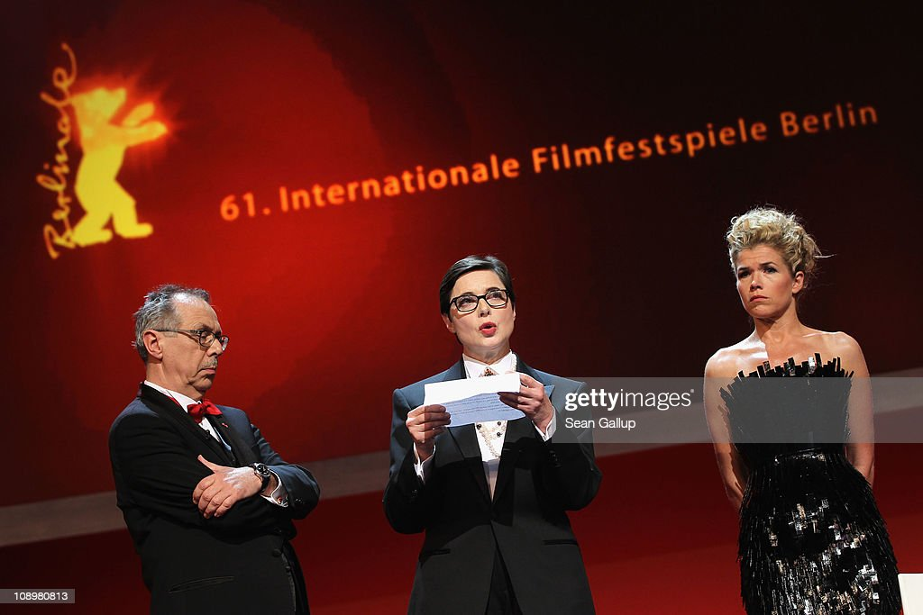 Isabella Rossellini reads a letter of Iranian director and jury member Jafar Panahi, who is imprisoned in Iran, next to Dieter Kosslick and Anke Engelke at the grand opening ceremony during the opening day of the 61st Berlin International Film Festival at Berlinale Palace on February 10, 2011 in Berlin, Germany.