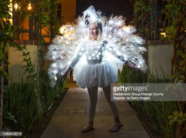 Isabella Sansevero wears the peacock costume her father and costume designer Giselle Becker made for her in 2014 The costume features white peacock...