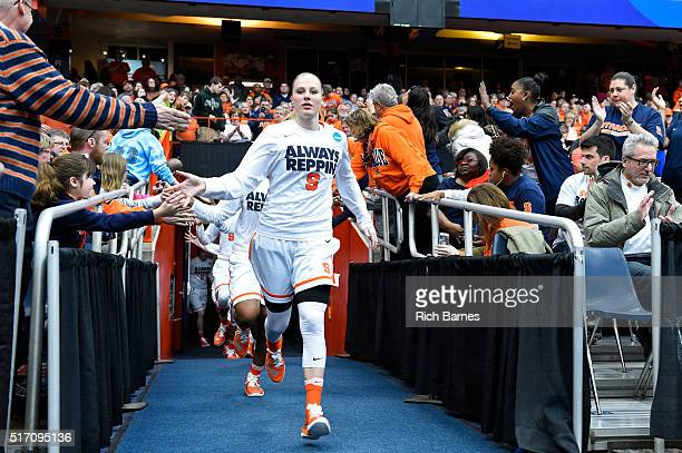 Isabella Slim of the Syracuse Orange leads her teammates to the court prior to the game against the Albany Great Danes in the second round of the...