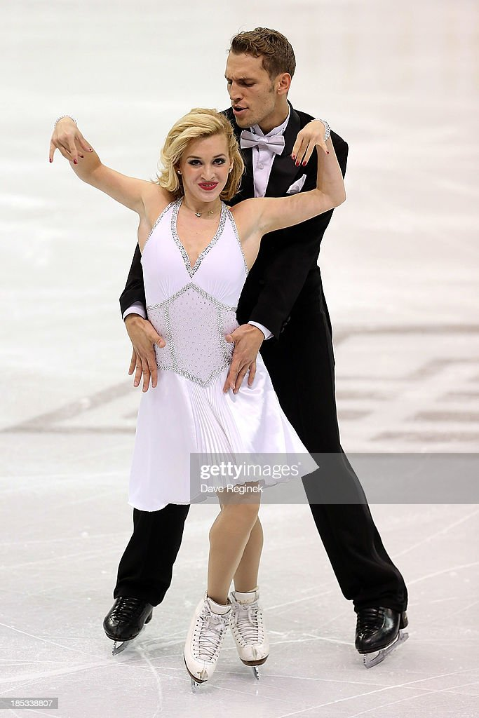 Isabella Tobias (L) and Deividas Stagniunas of Lithuania perform during the ice dance short program at Skate America at Joe Louis Arena on October 18, 2013 in Detroit, Michigan.
