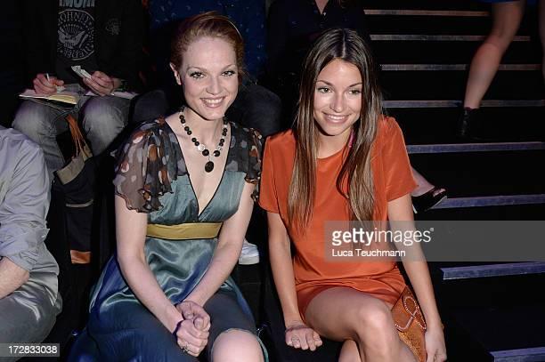 Isabella Vinet and Anna Julia Kapfelsperger attend the Umasan Show during MercedesBenz Fashion Week Spring/Summer 2014 at Brandenburg Gate on July 5...