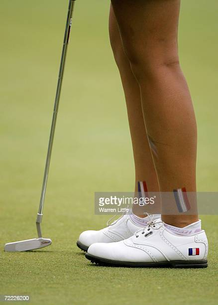 Isabelle Boineau of France shows off her team spirit during the third round of the Espirito Santo Trophy at Stellenbosch Golf Club on October 20 2006...