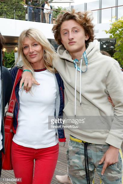 Isabelle Camus and her son Joaluka Noah attend the 2019 French Tennis Open Day Thirteen at Roland Garros on June 07 2019 in Paris France
