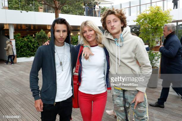 Isabelle Camus standing between her son Joaluka Noah and Liam Pioline attend the 2019 French Tennis Open Day Thirteen at Roland Garros on June 07...