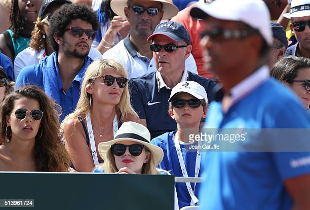 Isabelle Camus wife of Yannick Noah and their son Joalukas Noah look on while Yannick Noah stands on the court as captain of Team France during day 2...