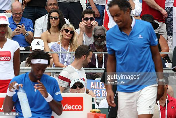 Isabelle Camus wife of Yannick Noah and Yannick's father Zacharie Noah look on while captain of France Yannick Noah and Gael Monfils stand on the...