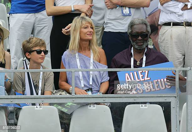 Isabelle Camus wife of Yannick Noah attends between their son Joalukas Noah and Yannick's father Zacharie Noah day 1 of the Davis Cup World Group...