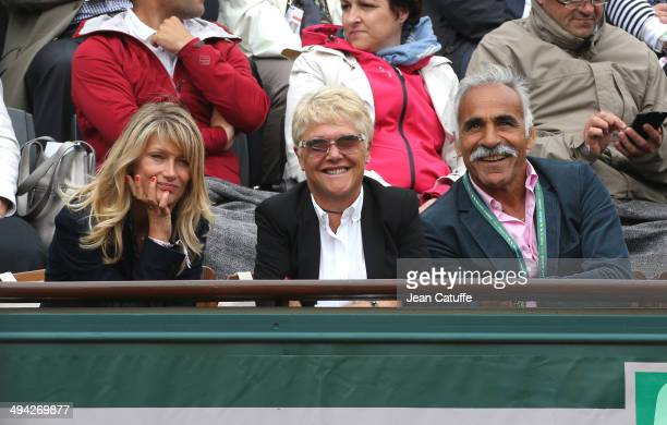 Isabelle Camus, wife of Yannick Noah, Frederique Bahrami and husband Mansour Bahrami attend Day 3 of the French Open 2014 held at Roland-Garros...