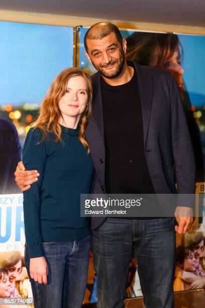 Isabelle Carre and Ramzy Bedia attend the 'Une Vie Ailleurs' Paris Premiere at UGC Cine Cite des Halles on March 20 2017 in Paris France
