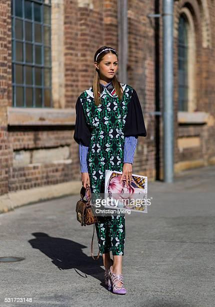 Isabelle Cornish wearing a green Miu Miu dress brown bag and pink heels outside Ginger Smart at MercedesBenz Fashion Week Resort 17 Collections at...