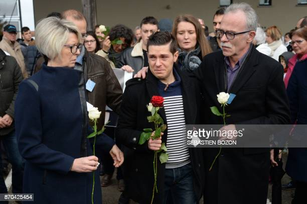 TOPSHOT Isabelle Fouillot and JeanPierre Fouillot the parents of murdered French woman Alexia Daval are joined by her husband Jonathann Daval and...