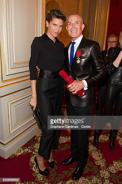 Isabelle Funaro and Jean Claude Jitrois pose after the Ceremony at Elysee Palace in Paris