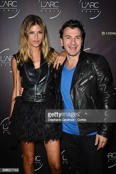Isabelle Funaro and Michael Youn attend the Arc Opening Party on October 3 2014 in Paris France