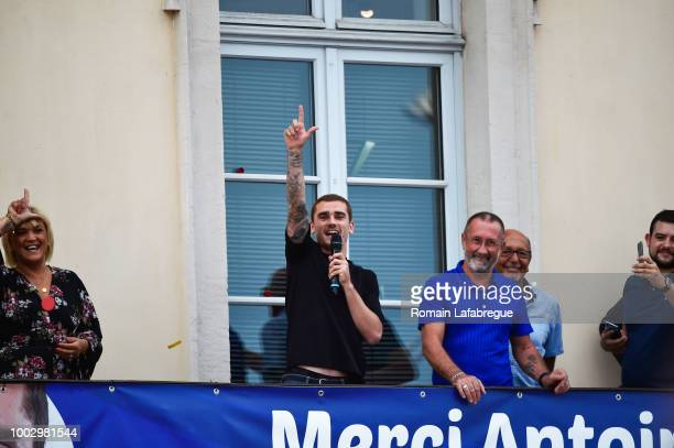 Isabelle Griezmann mother of Antoine Antoine Griezmann and Alain Griezmann father of Antoine celebrates France victory in World Cup in his hometown...