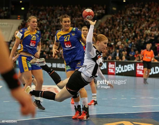 March 19: Isabelle Gullden of Sweden and Sabina Jacobsen of Sweden and Meike Schmelzer of Germany battle for the ball during the match Germany vs....