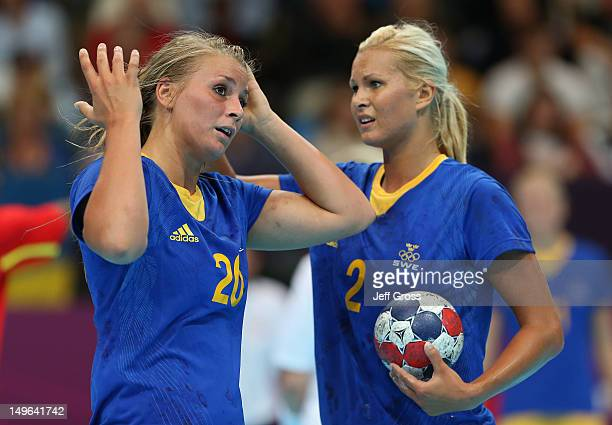 Isabelle Gullden of Sweden and Ulrika Agren of Sweden look on during the Women's Handball Preliminaries Group B - Match 12 between Sweden and Norway...